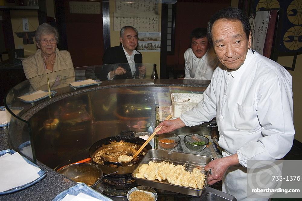 Chef cooking at tempura restaurant, Japan, Asia