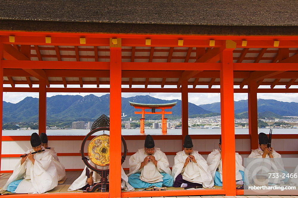 A Wedding Ceremony musical performance in front of the Floating Torii Gate at Itsukushima Shrine, founded in 593, UNESCO World Heritage Site, Miyajima Island, Hiroshima prefecture, Honshu Island, Japan, Asia