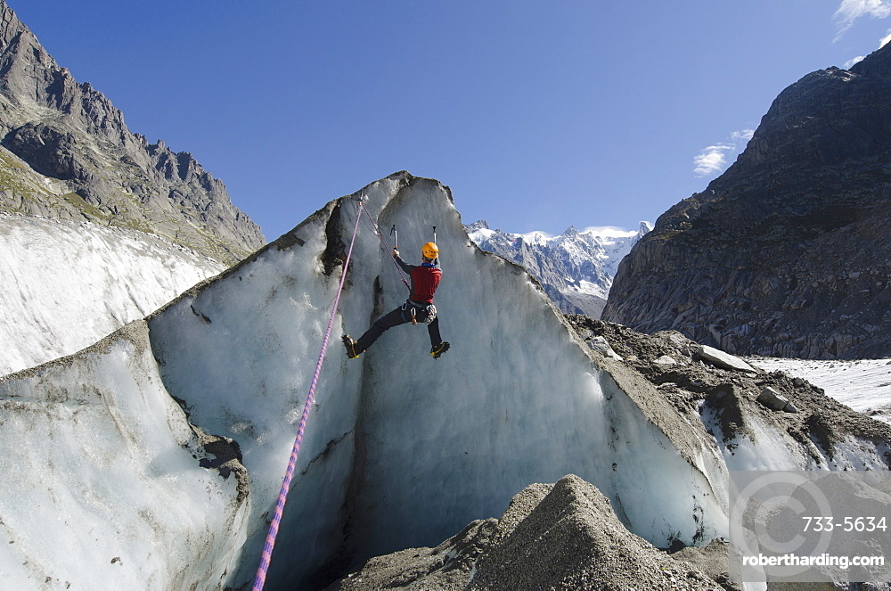 Ice climber at Mer de Glace glacier, Chamonix, Haute-Savoie, French Alps, France, Europe