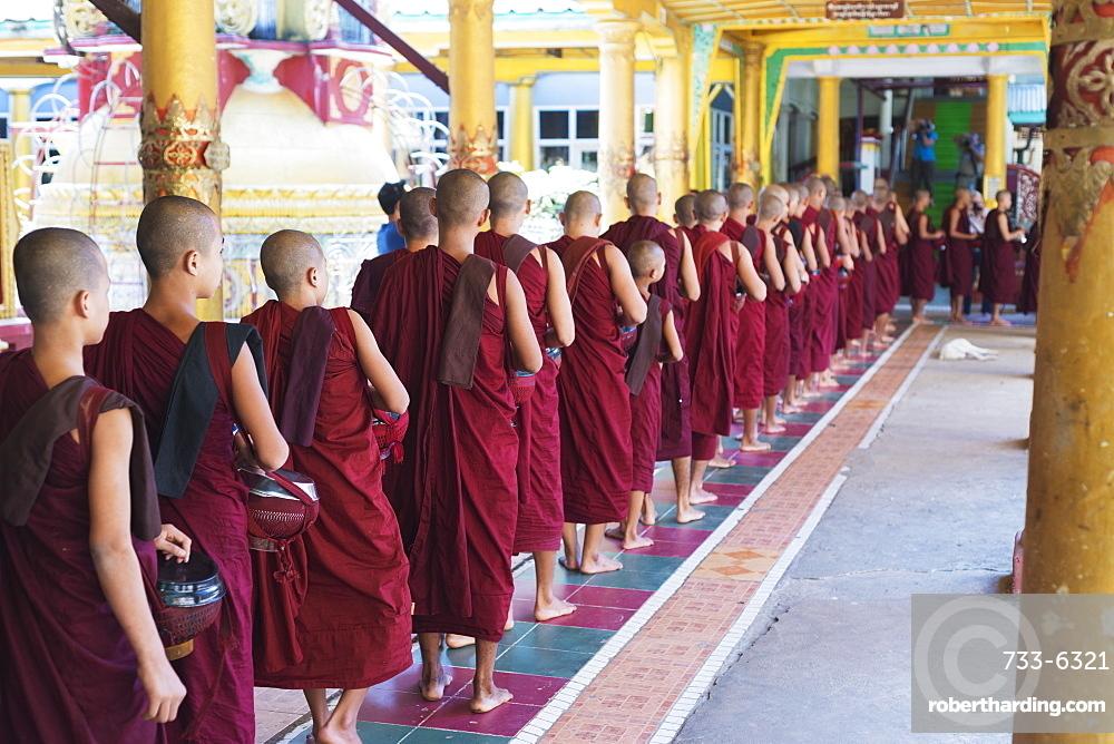 Meal time at the Kha Khat Wain Kyaung monastery, Bago, Myanmar (Burma), Asia