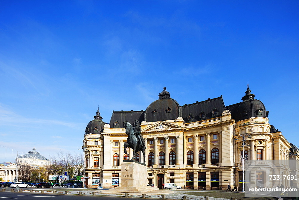 Central University library and statue of King Carol I of Romania, Bucharest, Romania, Europe