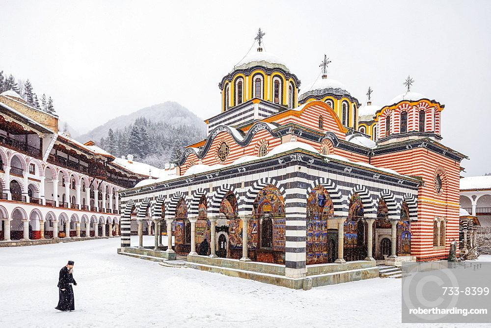 A priest at the Church of the Nativity of the Virgin Mother at Rila Monastery, UNESCO World Heritage Site, Bulgaria, Europe