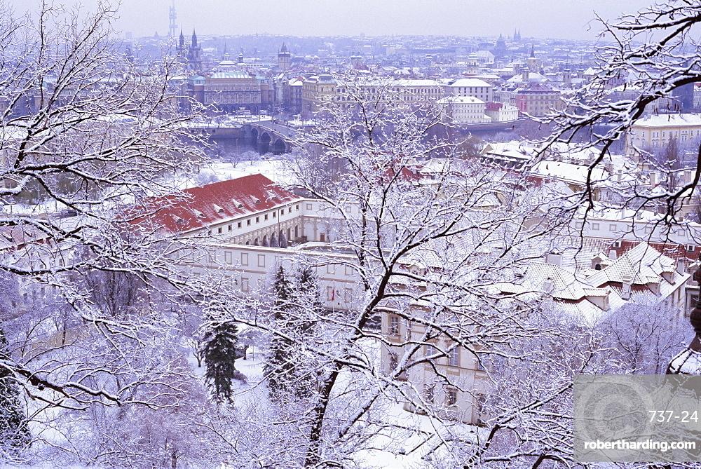 Snow covered Mala Strana and Stare Mesto rooftops, Prague, Czech Republic, Europe