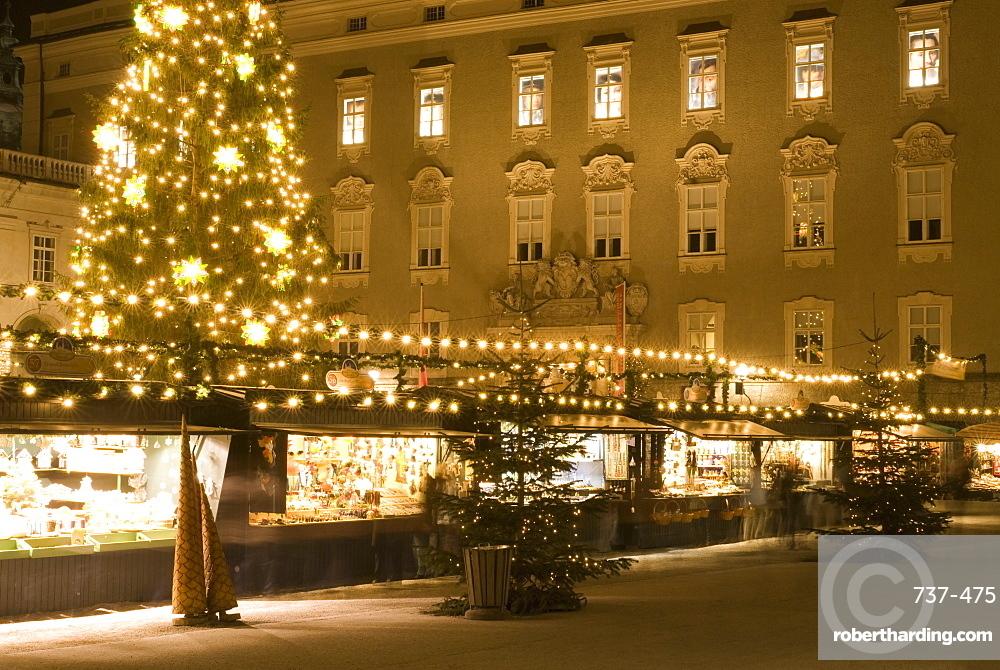 Historical Salzburg Christkindlmarkt (Christmas market) with stalls and Rezidens building at night, Residenzplatz, Salzburg, Austria, Europe