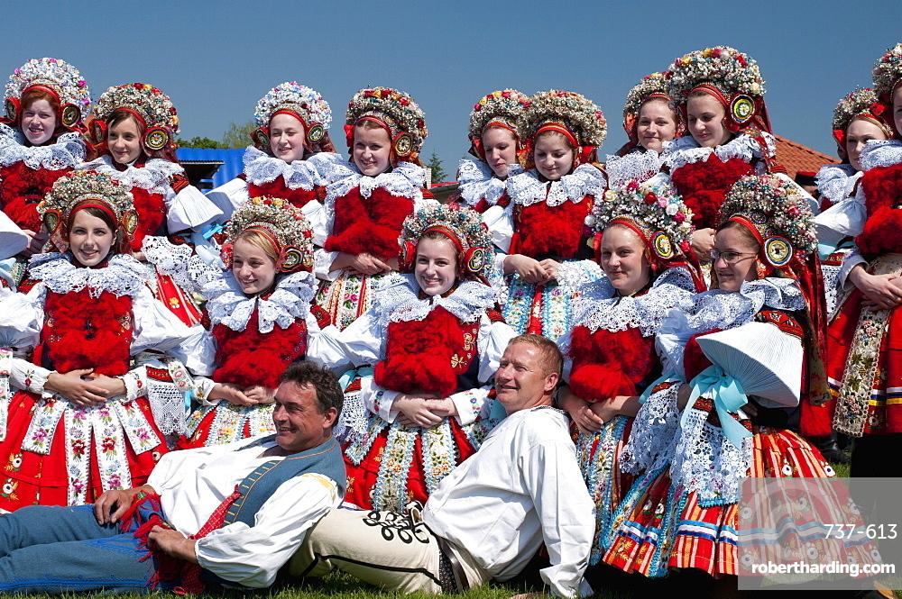 Girls and men wearing folk dress, The Ride of the Kings festival, Vlcnov, Zlinsko, Czech Republic, Europe