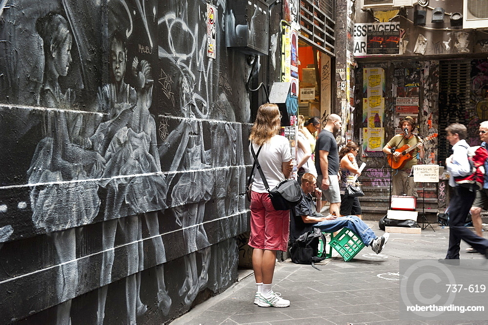 Graffiti and people watching street musician, Central Place, Melbourne, Victoria, Australia, Pacific
