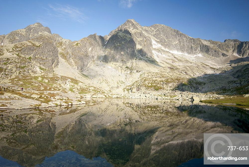 Reflection of Tatra peaks in Spis Lake Valley, High Tatra Mountains, Slovakia, Europe
