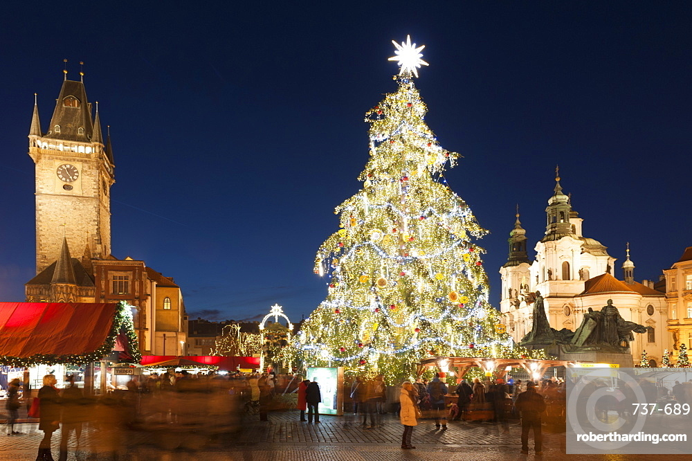 Christmas Market at Old Town Square with Gothic Old Town Hall, Jan Hus Monument and Baroque Church of St. Nicholas at twilight, Old Town, UNESCO World Heritage Site, Prague, Czech Republic, Europe