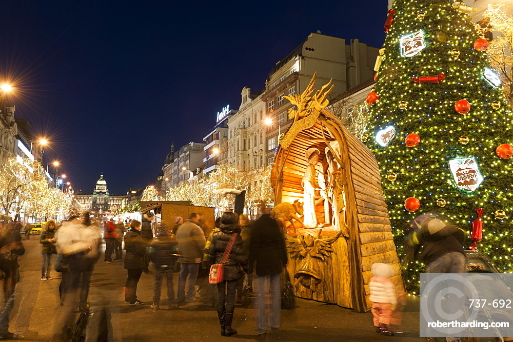 Christmas Market and Christmas tree, Nativity Scene and National Museum at Wenceslas Square during Advent evening, Nove Mesto, Prague, Czech  Republic, Europe