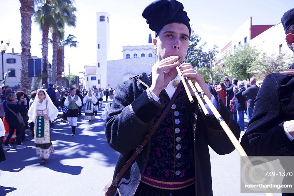 Man playing the Launeddas during the Saint Antioco parade, Sant'Antioco, Sardinia, Italy, Europe