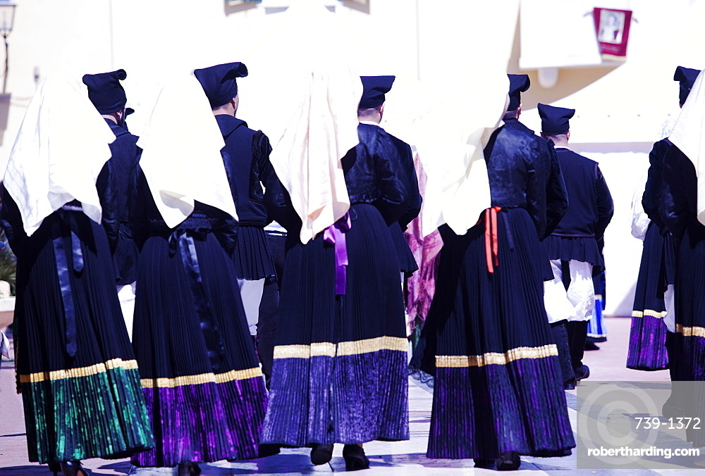 Men and women in traditional costume during the Saint Antioco procession, Sant'Antioco, Sardinia, Italy, Europe