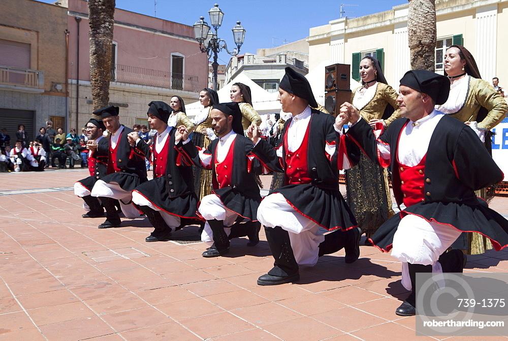 Men kneeling celebrating St. Antioco, patron saint of Sardinia, Sant'Antioco, Sardinia, Italy, Europe