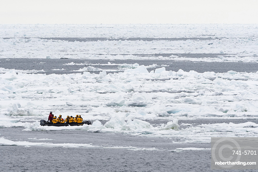 Tourists on inflatable boats exploring the Polar Ice Cap, 81 degrees, north of Spitsbergen, Svalbard, Arctic, Norway, Europe