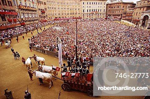 Piazza del Campo during the historical parade preceeding the Palio, Siena, Tuscany, Italy