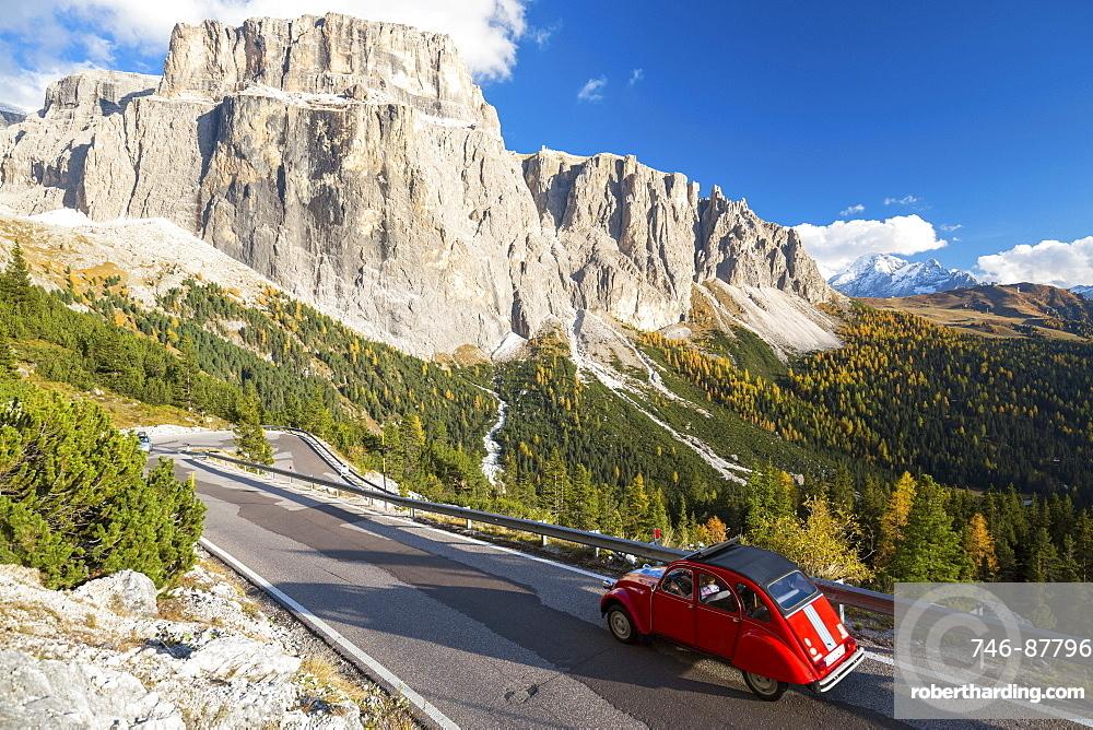 Citroen 2 CV on the road from Sella Pass, Trentino-Alto Adige, Italy, Europe