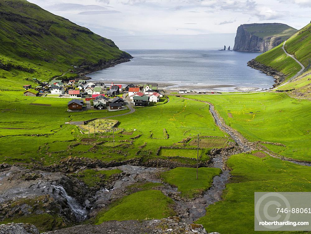 Village Tjornuvik. In the background the island Eysturoy with the iconic sea stacks Risin and Kellingin, North Atlantic.  Europe, Northern Europe, Denmark, Faroe Islands
