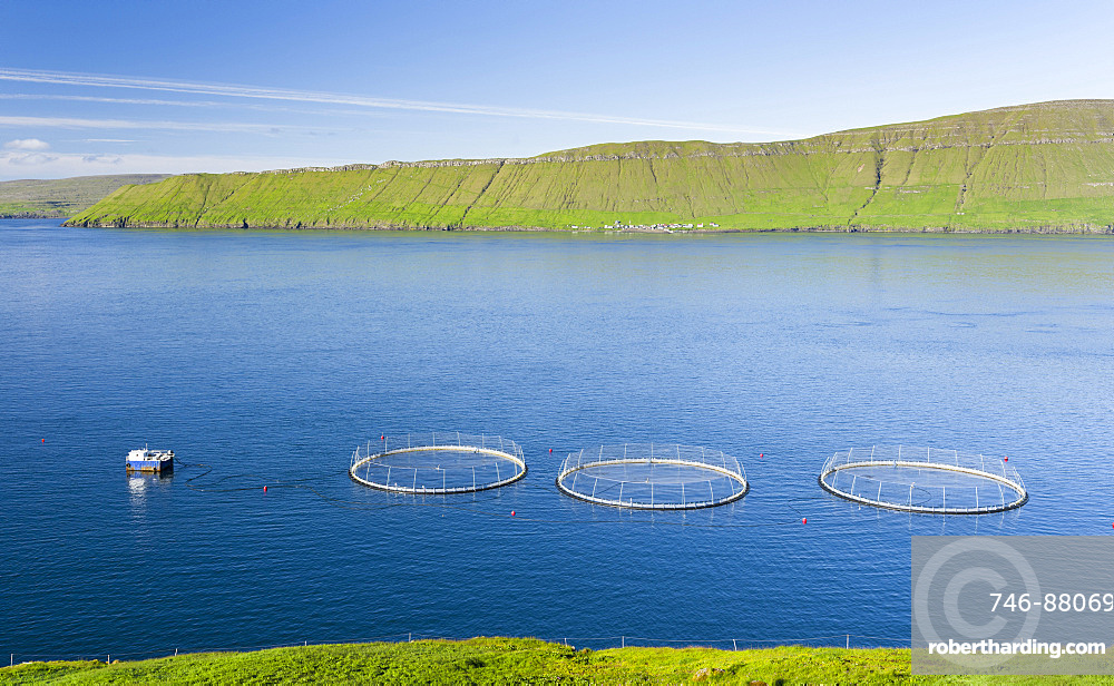 Hestfjordur with fish farms,  Hestur in the background. The island Streymoy, one of the two large islands of the Faroe Islands  in the North Atlantic.  Europe, Northern Europe, Denmark, Faroe Islands