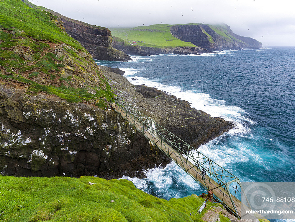 The bridge between mykinesholmur and Mykines. The island Mykines, part of the Faroe Islands in the North Atlantic, Denmark, Northern Europe