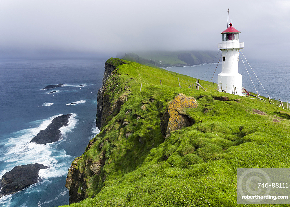 The lighthouse on Mykinesholmur, The island Mykines, part of the Faroe Islands in the North Atlantic, Denmark, Northern Europe