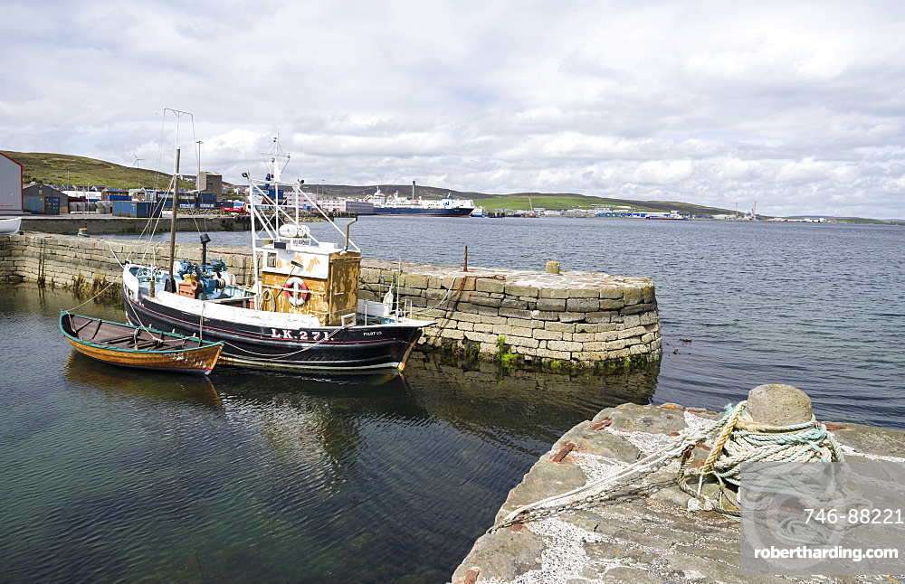 Lerwick, the capital of the Shetland Islands in the far north of Scotland.  Historic Hays Dock and Hays Quay, old fishing boat, the new commercial harbour in the background. Europe, northern europe, great britain, scotland, Shetland Islands, June