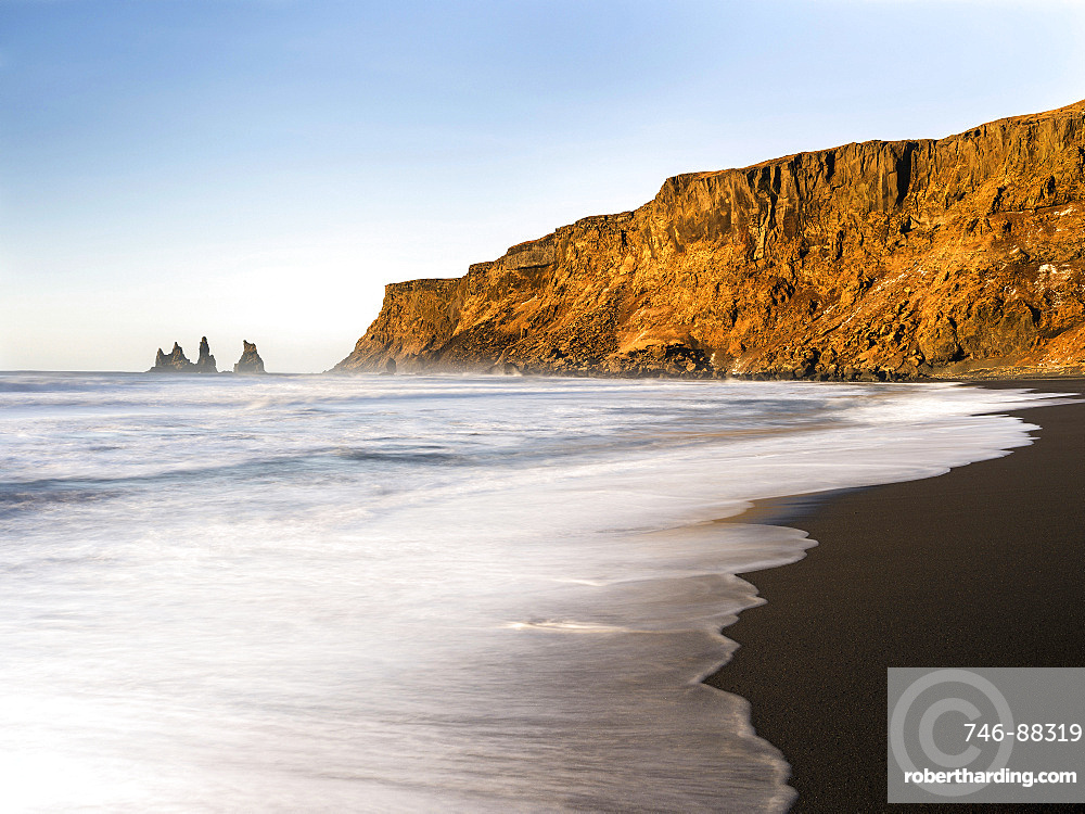 Coast of the North Atlantic near Vik y Myrdal during winter. Beach during sunrise with the sea stacks called Reynisdrangar. europe, northern europe, scandinavia, iceland,  February