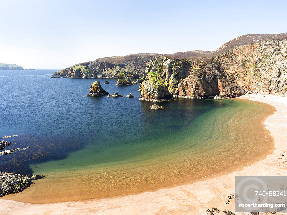 Muckle Roe, a small island of the Shetland Islands. Muckle Roe  (big red isle) is famous for the red, unspoilt granite cliffs and beaches. europe, central europe, northern europe, united kingdom, great britain, scotland, northern isles,shetland islands islands, May