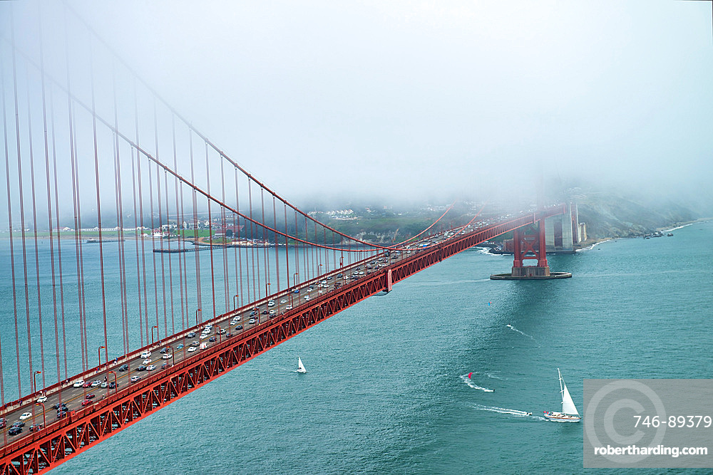 Golden Gate Bridge surrounded by fog, San Francisco.