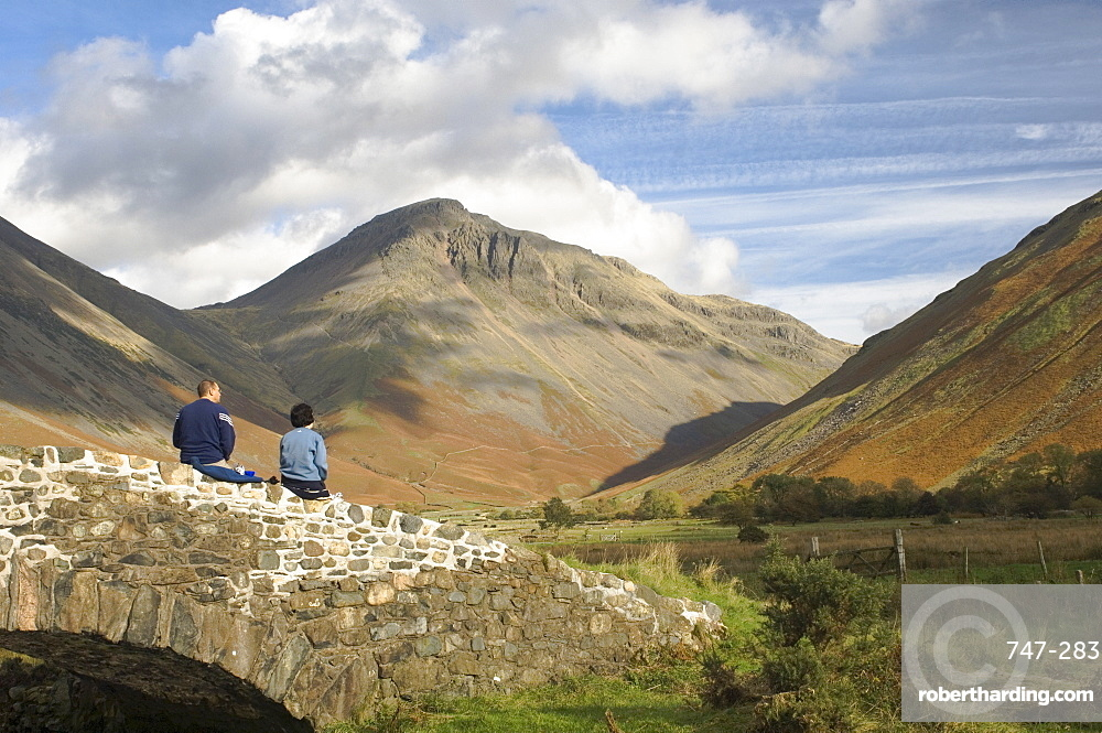 Two walkers resting, looking to Great Gable 2949ft, Wasdale Valley, Lake District National Park, Cumbria, England, United Kingdom, Europe