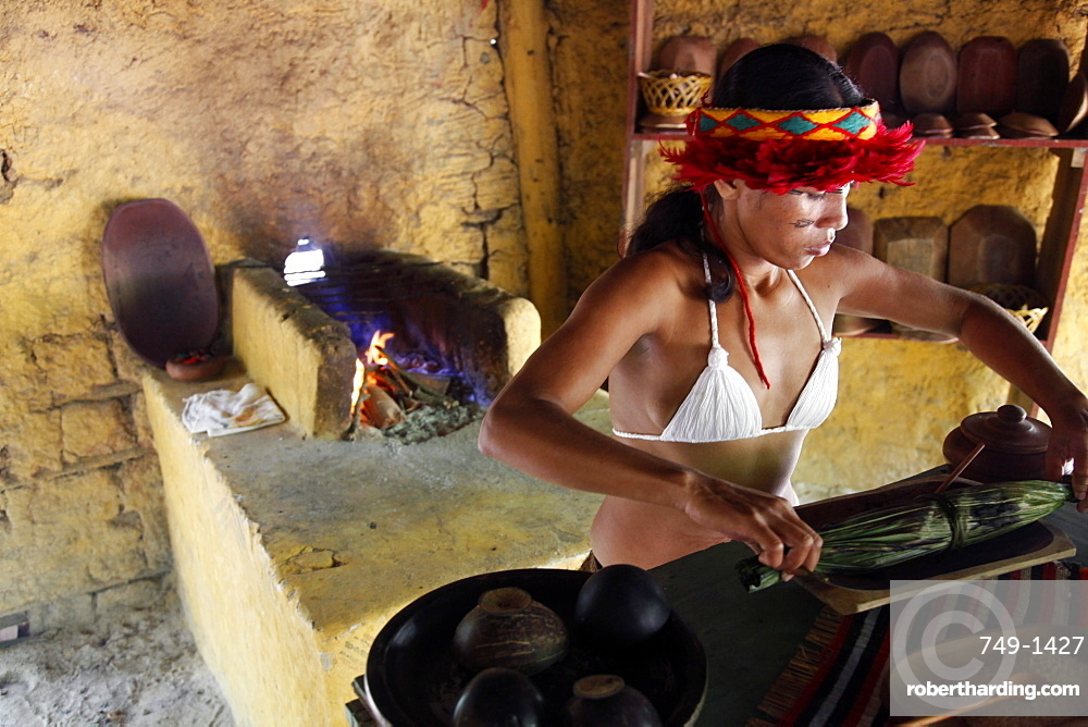 Pataxo Indian woman making food at the Reserva Indigena da Jaqueira near Porto Seguro, Bahia, Brazil, South America