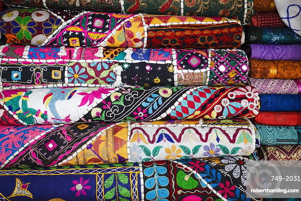 Colourful hand woven fabrics at Mapusa Market, Goa, India, Asia