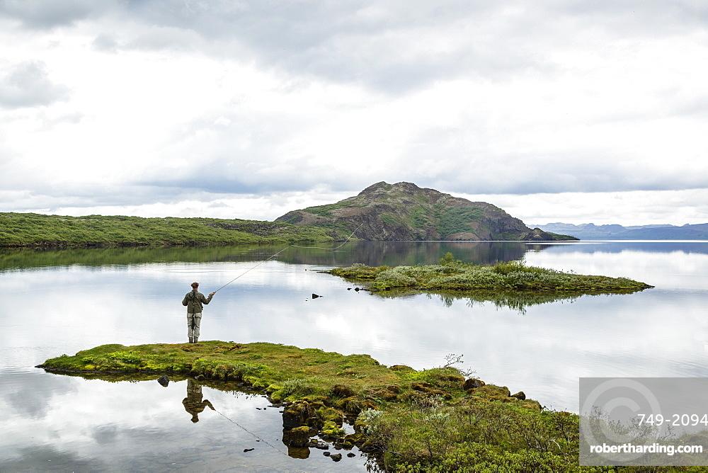 Man fishing at Thingvallavatn lake, Thingvellir (Pingvellir) National Park, UNESCO World Heritage Site, Golden Circle, Iceland, Polar Regions