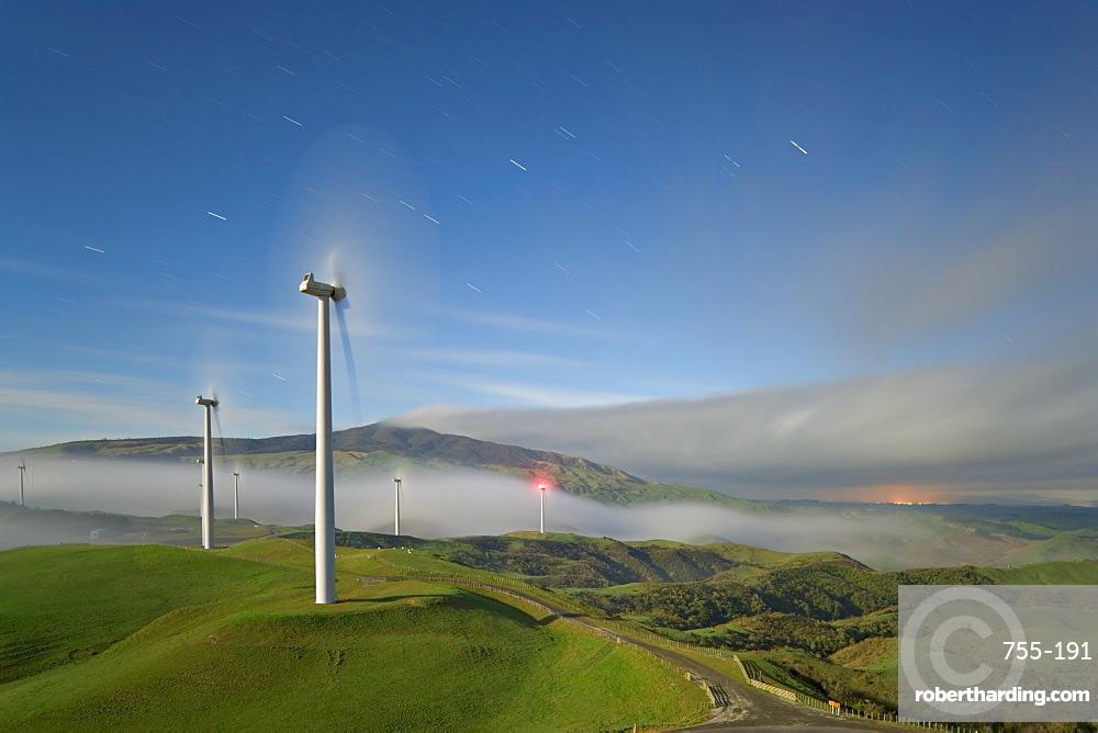 A long exposure by moonlight of windmills in Te Apiti Wind Farm, Palmerston North, Manawatu, North Island, New Zealand, Pacific