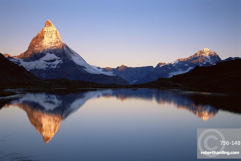 Matterhorn from Riffelsee at dawn, Zermatt, Swiss Alps, Switzerland, Europe