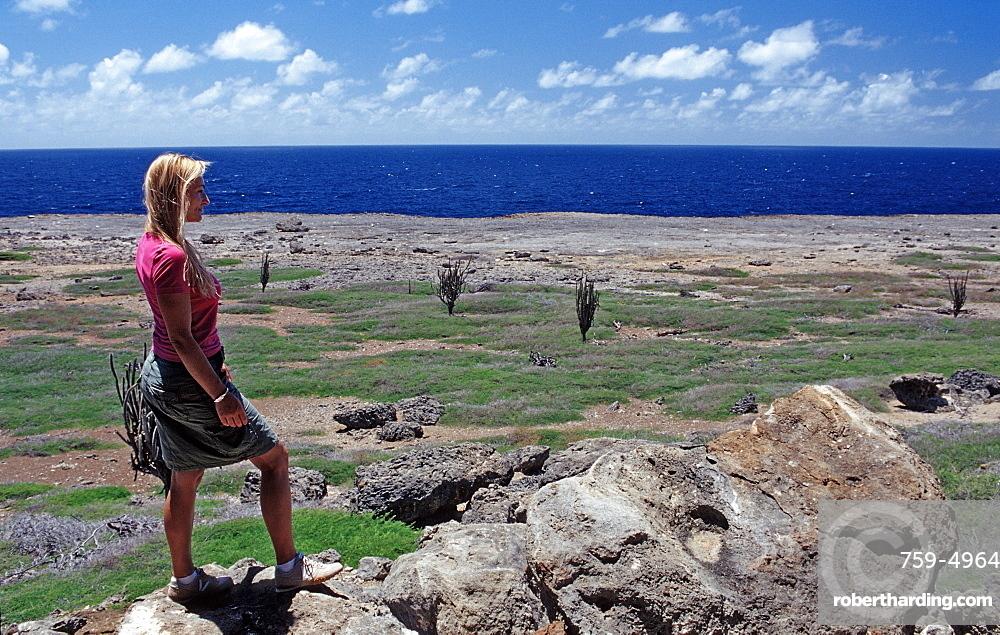 Woman and Desert landscape, Netherlands Antilles, Bonaire, Bonaire, Washington Slagbaai National Park