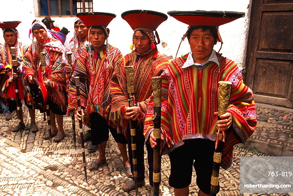 Pisac Sunday Market near Cuzco in Valley of the Incas one of the world's great markets village elders with traditional staffs, Cuzco area, Highlands, Peru