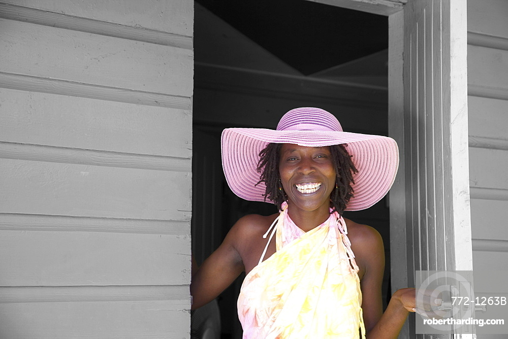 Jamaican woman in pink hat, Negril, Jamaica, West Indies, Caribbean, Central America