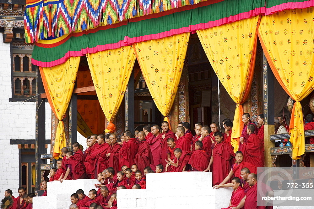 Buddhist monks watching festival (Tsechu), Trashi Chhoe Dzong, Thimphu, Bhutan, Asia