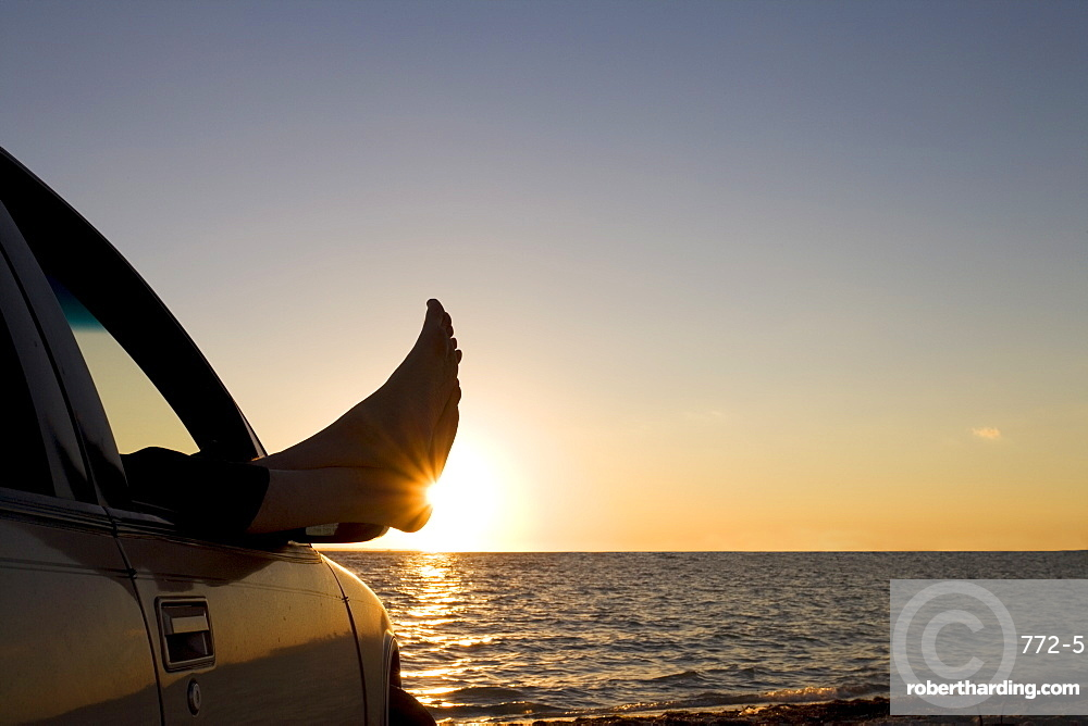 Man's feet at sunset, Key Byscaine, Miami, Florida, United States of America, North America