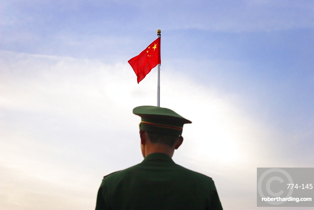 Military police prepare to lower the national flag in Tiananmen Square, Beijing, China, Asia