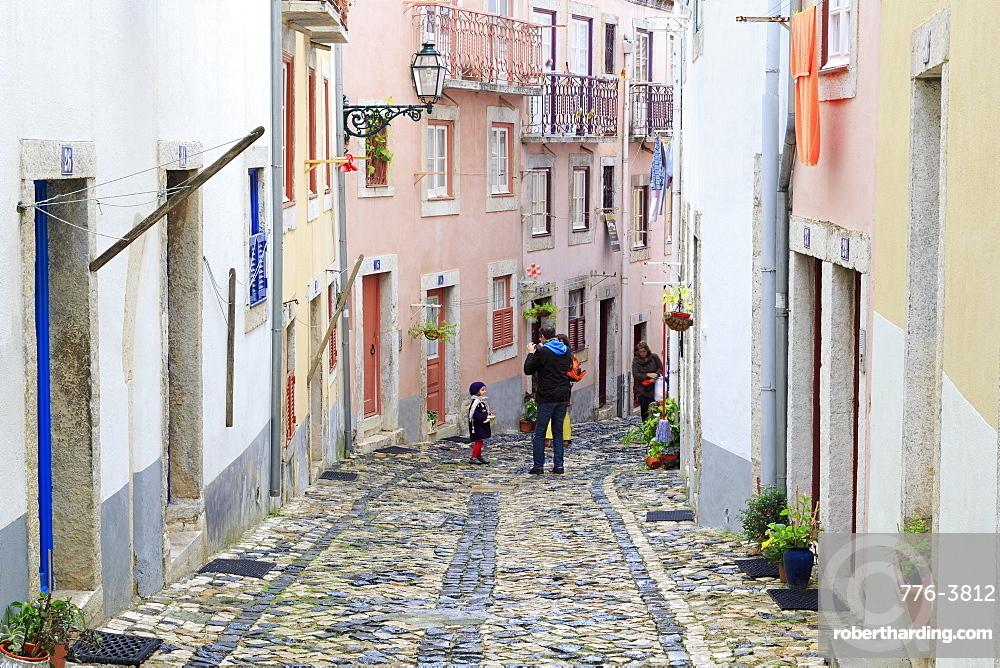 Narrow street in the Castelo District, Lisbon, Portugal, Europe