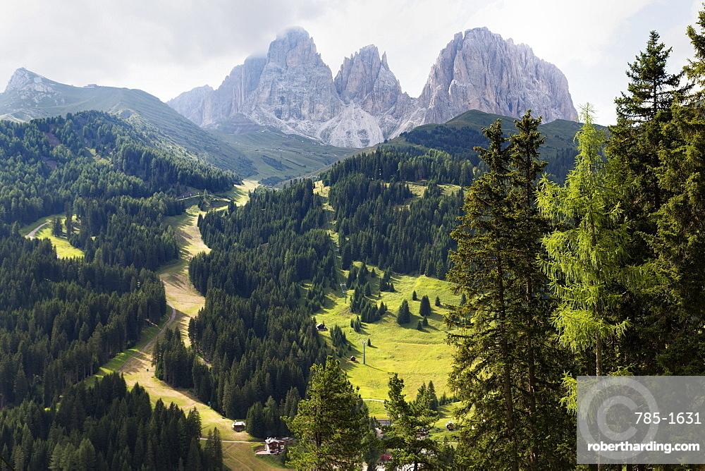 The dramatic Sassolungo mountains in the Dolomites near Canazei, Trentino-Alto Adige, Italy, Europe