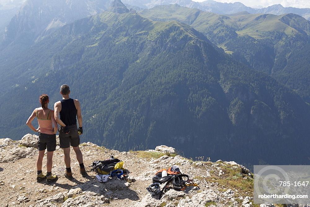 Climbers on the Sassolungo mountains in the Dolomites near Canazei, Italy, Europe