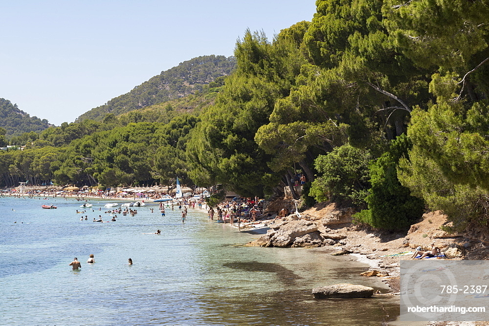People relaxing in the calm waters of the beautiful bay of Playa (Platja) de Formentor on the northern coast of Mallorca