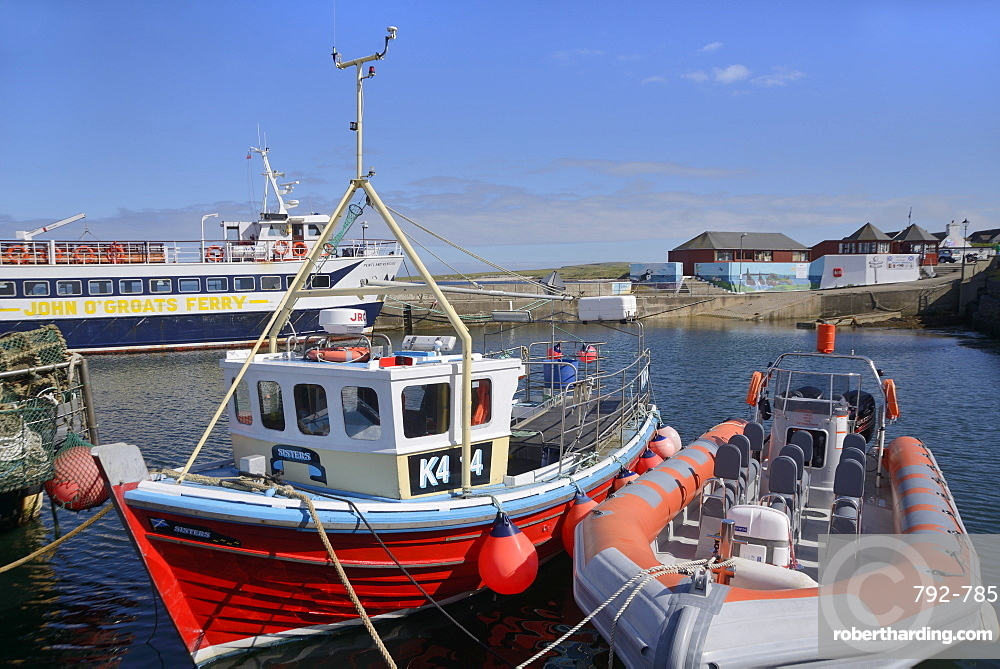 Fishing boat and rigid-inflatable boat in the harbour, John O'Groats, Caithness, Highland Region, Scotland, United Kingdom, Europe