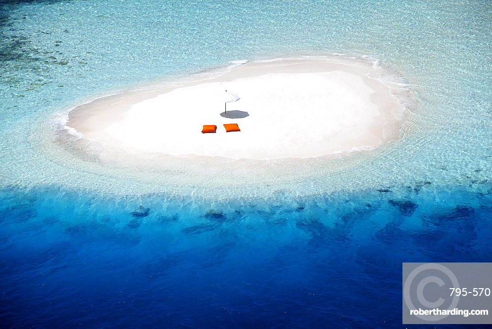 Aerial view of a sandbank, pillows and sun umbrella , Maldives, Indian Ocean, Asia