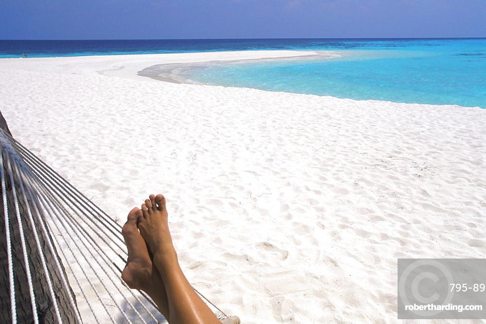 Woman barefoot in hammock, Maldives, Indian Ocean, Asia