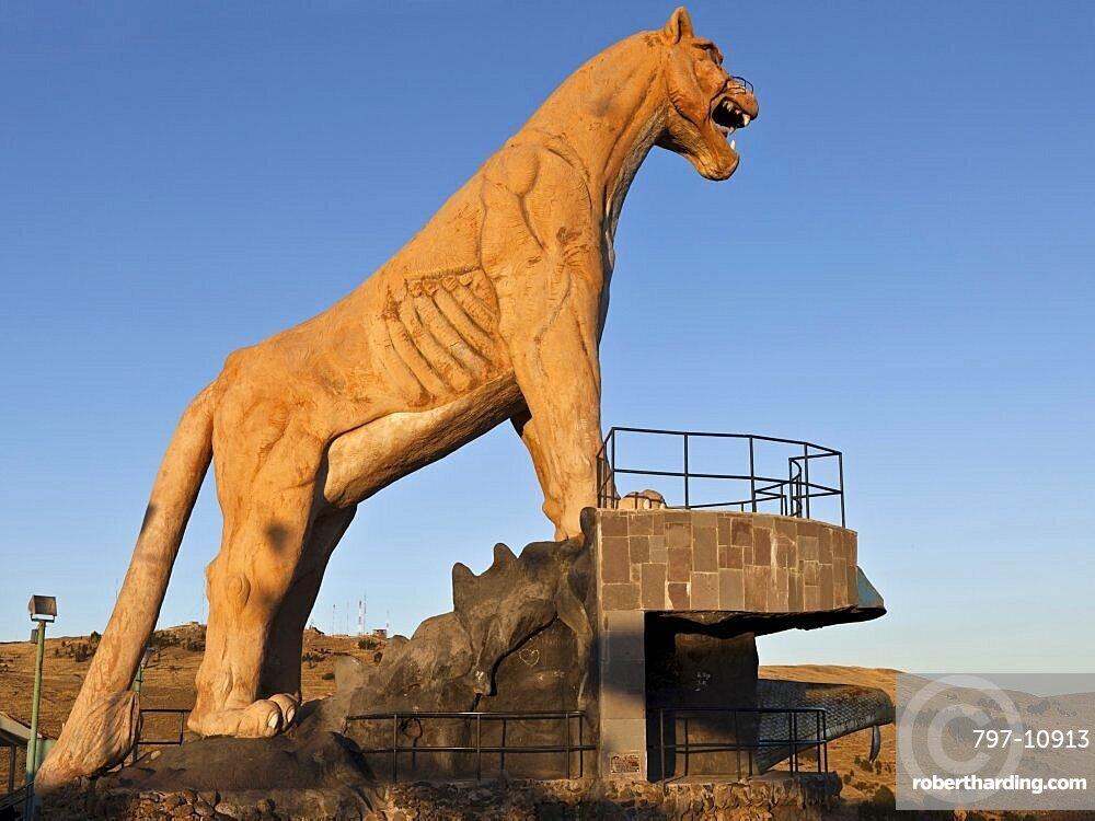 Peru, Puno, Stone statue of a Puma overlooking the city and Lake Titicaca.