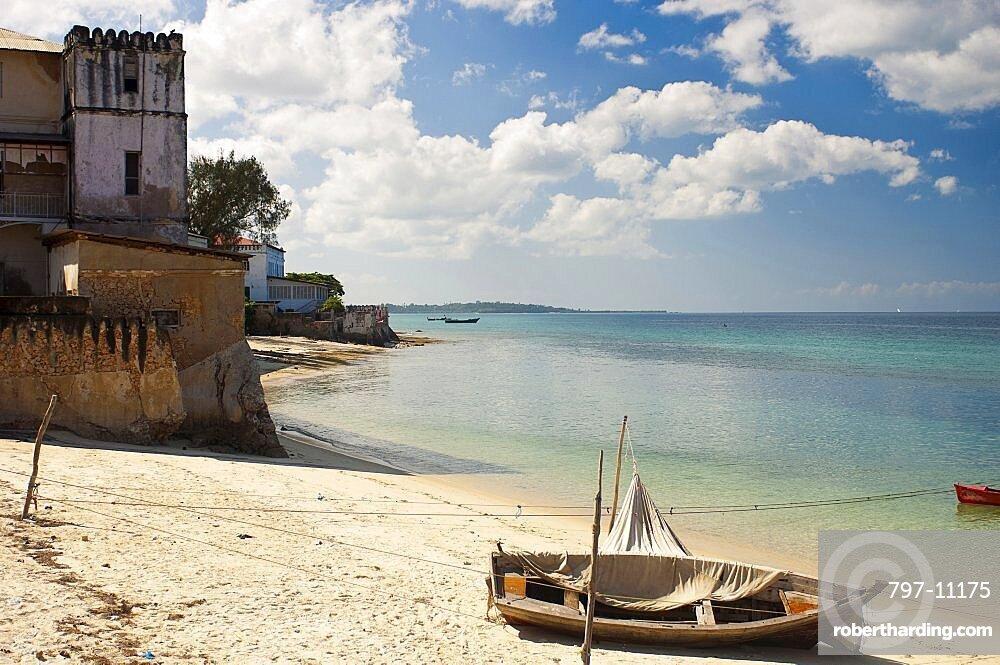 Tanzania, Zanzibar, Stone Town, Looking along the golden sands of the beach.