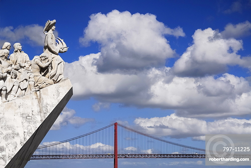 Portugal, Estremadura, Lisbon, Padrao dos Descobrimentos Carving of Prince Henry the Navigator leading the Discoveries Monument with the Ponte 25th Abril Bridge behind.
