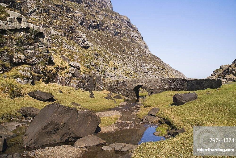 Ireland, County Kerry, Killarney, Gap of Dunloe with old stone bridge crossing mountain stream.